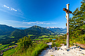 Weather cross in Reit im Winkl with a view of Kaiserwinkl and Tyrolean Alps in autumn, Chiemgau, Bavaria, Germany