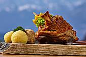Bavarian pork knuckle enjoyed with a view, Winklmoos Alm, Reit im Winkl, Chiemgau, Bavaria, Germany
