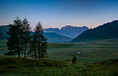 Summer sunrise on the meadows of Casera Feston in the Carnic Alps near Sauris, Udine in Friuli Region. Italy