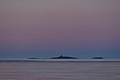 Small islands in the sea in the early morning light, Grimsholmen, Halland, Sweden