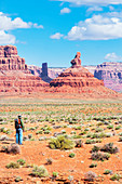 Man contemplating landscape, Valley of the Gods, Utah, USA