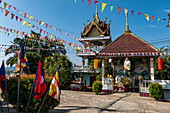 Colorful flags at the Vat Chom Khao Manilat Temple, Houayxay (Huay Xai), Bokeo Province, Laos, Asia
