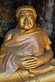 Golden Buddha figure on a path to Mount Phousi, Luang Prabang, Luang Prabang Province, Laos, Asia