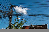 A chaotic but functional cluster of telephone and power lines, Luang Prabang, Luang Prabang Province, Laos, Asia