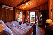 Interior view of a cabin on board the river cruise ship Mekong Sun on the Mekong river, Luang Prabang, Luang Prabang Province, Laos, Asia