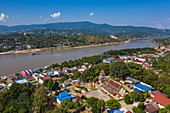 Aerial view of Vat Chom Khao Manilat Temple with Mekong River behind, Huoayxay (Huay Xai), Bokeo Province, Laos, Asia