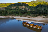 Aerial view of river cruise ship Mekong Sun moored on the sandy bank of the Mekong River, Ban Hoy Palam, Pak Tha District, Bokeo Province, Laos, Asia