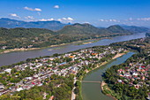 Aerial view of the city with the confluence of the Nam Khan River (foreground) and the Mekong River, Luang Prabang, Luang Prabang Province, Laos, Asia