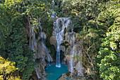 Aerial view of the magnificent Kuang Si Falls amidst lush jungle vegetation, Kuang Si, Luang Prabang Province, Laos, Asia