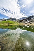 Sunlight over mountain peaks overlooking Porcile Lakes, Tartano Valley, Valtellina, Sondrio province, Lombardy, Italy, Europe