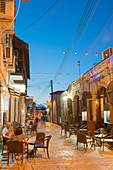 People eating at a restaurant outdoors at night in Latchi, Cyprus, Mediterranean, Europe