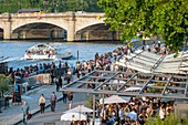 France, Paris, area listed as World Heritage by UNESCO, the New Pedestrian Berges at the Port of the Champs Elysees, cafes and restaurants on the docks