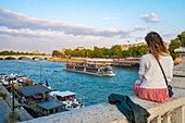 France, Paris, area listed as World Heritage by UNESCO, tourist on the Alexandre III bridge and the fly boats