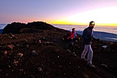 France, Reunion island, Cilaos, Salazie, hikers on the ridge of Piton des Neiges at sunset listed as World Heritage by UNESCO