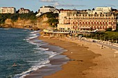 France, Pyrenees Atlantiques, Basque Country, Biarritz, the Grande Plage (town's largest beach) and the Hotel du Palais, stand up paddle