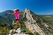 France, Alpes-de-Haute-Provence, Verdon Regional Nature Park, Grand Canyon du Verdon, cliff Les Grands Vernis (993m), Verdon and Lake St Croix, woman practicing trail