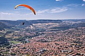 France, Aveyron, Parc Naturel Regional des Grands Causses (Natural Regional Park of Grands Causses), Millau, flight in paragliding over Millau, the viaduct in the background