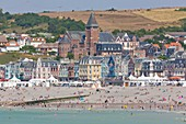 France, Somme, Mers les Bains, beach cabins and seaside architecture villas, in the background Saint Martin church