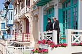France, Somme, Mers les Bains, swimmers' day, couple dressed in belle ?poque costume on a balcony