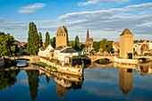 France, Bas Rhin, Strasbourg, old city listed as World Heritage by UNESCO, Petite France district, the covered bridges spanning the Ill and the Notre Dame cathedral