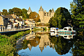 France, Morbihan, stop on the Way of St James, Josselin, medieval village, Josselin castle in flaming gothic style on the Oust River banks