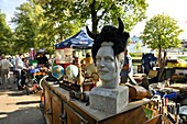 France, Nord, Lille, 2017 clearance sale, second-hand dealers along the esplanade, sculpture of a mustachioed man's head surmounted by horns in a moumoute