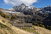 View of the abandoned Alpe Cuneggio and the Poncione Rosso towering behind it, Lepontine Alps, Ticino, Switzerland
