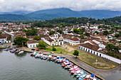 Aerial view of fishing boats on pier with Igreja de Santo Rita Church, Paraty, Rio de Janeiro, Brazil, South America