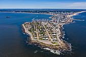 Aerial view of peninsula with Faro de Punta del Este lighthouse, city and expedition cruise ship World Explorer (Nicko Cruises) in the distance, Punta del Este, Maldonado Department, Uruguay, South America