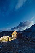 Woman in the mountains in Raetikon, Vorarlberg, Austria, Europe