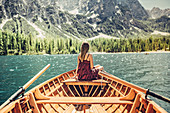 Woman on a boat trip on Lake Braies amid the Dolomites in South Tyrol, Italy, Europe