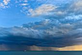 A rain front with dark clouds over the sea, Darwin, Northern Territory, Australia