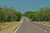 Road shimmering in the heat, Kakadu National Park, Jabiru, Northern Territory, Australia