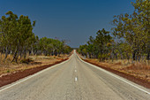 A lonely highway leads to the horizon at Edith Falls, Northern Territory, Australia
