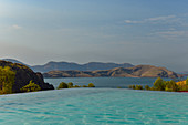 Infinity pool in front of the lake with mountains in the background, Lake Argyle, Western Australia, Australia