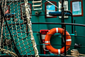 Net and lifebuoy on a fishing boat in Groningen, the Netherlands