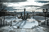 View of the anchor and the city of Murmansk with mountains in the background, Russia