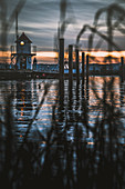 Mini lighthouse at the Mönkeberg marina at sunset, Kiel, Germany