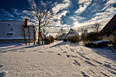 Snow-covered country houses. Dorum, Lower Saxony, Germany