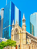 St Stephen's Cathedral dwarfed by glass skyscrapers, Brisbane, Queensland, Australia