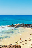People swimming in Champagne pools, Great Sandy National Park, Fraser Island, Queensland, Australia,