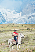 Cowboy on horseback, Torres del Paine National Park, Chile