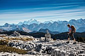 France, Haute Savoie, massif des Bornes, Glieres plateau, hiking in the mountain of Sous Dine, in the lapias of the summit seen towards the Mont Blanc