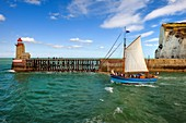 France, Seine Maritime, Pays de Caux, Cote d'Albatre, Fecamp, the old sailing ship Tante Fine leaves the port in front of the Pointe Fagnet lighthouse