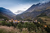 France, Hautes Alpes, The massive Grave of Oisans, the village at the foot of the Meije and its valleys in the crepuscule