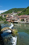 France, Doubs, Loue valley, one of many thresholds over the river reflect the village of Lods one of the most beautiful villages in France