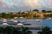 Martinique, Caribbean Sea, Bay of Fort de France, Flemish Bay at sunrise overlooking the pontoons, Fort Saint-Louis, La Savane and in the background a liner at the pier