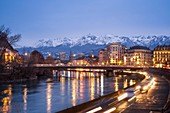 France, Isere, Grenoble, dusk on the banks of Isere river, Belledonne massif in the background