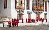 Buddhist monks, prayer time, Kurjey Lhakhang Monastery, Bumthang, Bhutan, Asia