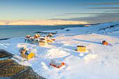 Traditional houses in the snow at dawn, Veines, Kongsfjord, Varanger Peninsula, Troms og Finnmark, Norway, Scandinavia, Europe